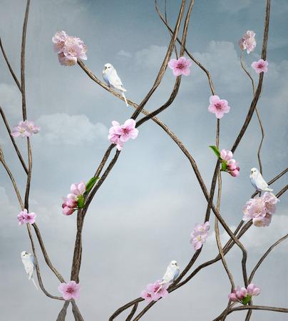 花が咲く枝にとまる白い鳥たち